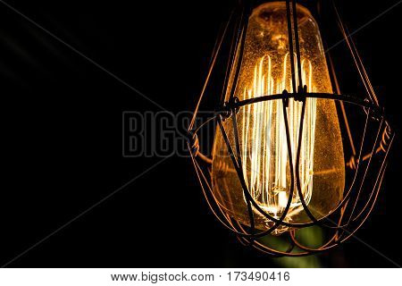 Light bulb with chain hanging from the ceiling
