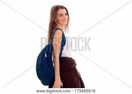 a young girl is worth turning sideways and keeps the shoulder Briefcase isolated on white