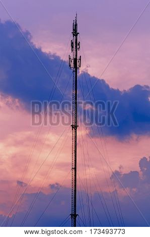Look beautiful sky background and telephone tower.Sky Bright Blue Orange And Yellow Colors Sunset. Instant Photo Toned Image