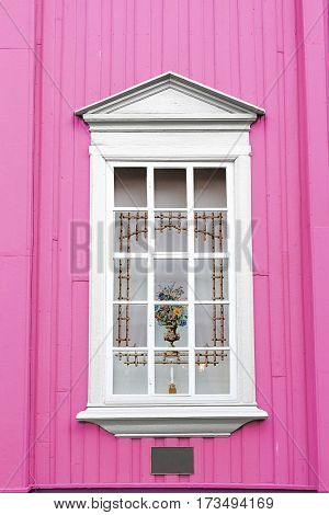 pink wall white window curtain vase candle holder