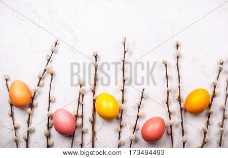 branches pussy willows and easter eggs on old background. Festive  Easter concept with copy space. Flat lay