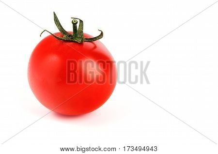 The red tomato isolated on white background. Soft selective focus and shallow depth of field