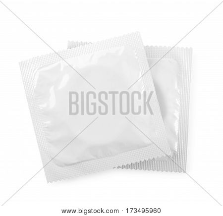 two condoms in a package on a white background contraception means