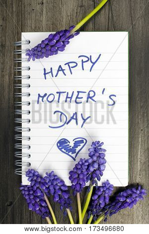 Muscari bouquet and notepad with words
