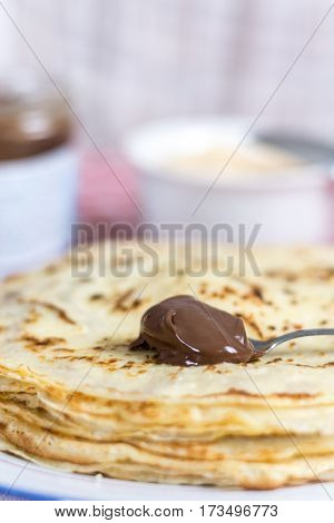 Chocolate Cream On The Spoon With Blurred Background