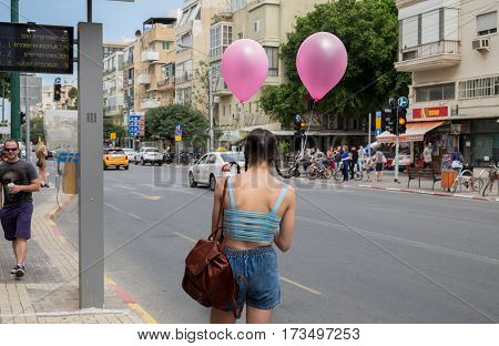 Jewish Girl With Balloons In Her Pigtails, Celebrate The Purim Holiday At Tel-aviv Street