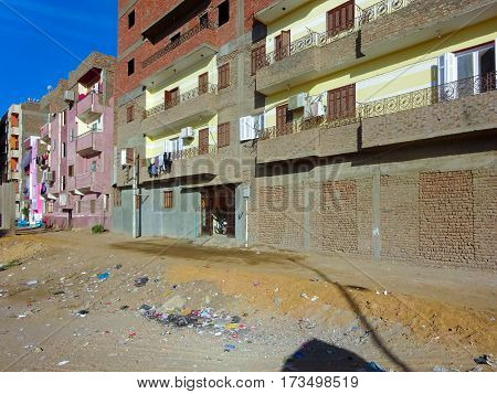 egyptian ghetto, view to the street where trashes lying on the floor