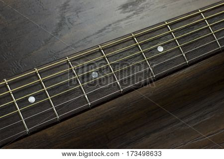 acoustic guitar neck fingerboard frets strings music case close inlay creativity art sound vibration play music guitarist