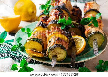 Greek-Style Chicken Skewers with zuccini and lemon.selective focus