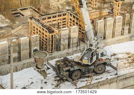 Tower Crane Bucket Full Of Concrete Liquid