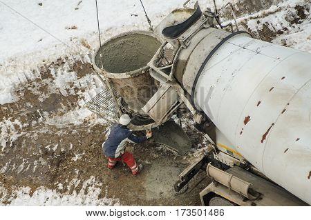 Concrete Mixer Truck Pouring Liquid Concrete Into The Tower Crane Bucket