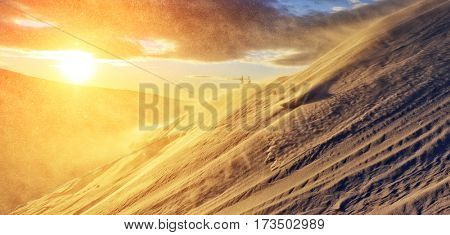 Exotic view of the snow dune in yellow light. Dramatic and gorgeous morning scene. Location place Carpathian, Ukraine, Europe. Artistic picture. Discover the world of beauty.