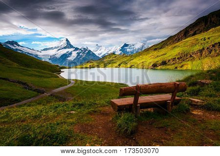 Great view of the snow rocky massif. Popular tourist attraction. Picturesque and gorgeous scene. Location place Bachalpsee in Swiss alps, Grindelwald valley, Bernese Oberland, Europe. Beauty world.