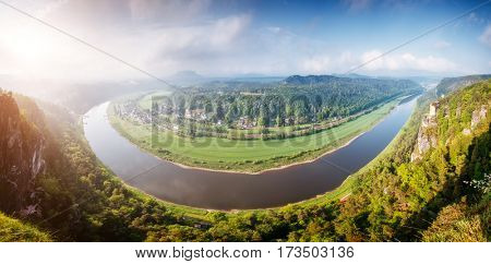 View of the Elbe valley in sunlight. Location place Saxony Switzerland national park south-east of Dresden, Germany, Europe. Popular tourist attraction. Dramatic and picturesque scene. Beauty world.