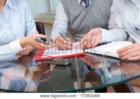 Image of business people hands working with papers at meeting poster