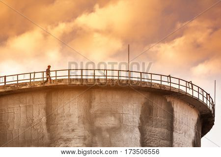 MOSCOW - SEPTEMBER 23 2015: Worker on the top of the cooling tower. Volgogradsky avenue is one of the most contaminated area in the city.