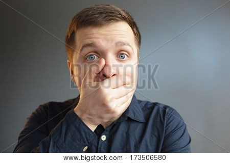 Man In Shock Closing Mouth With Her Hand. Keep Secret Carefully