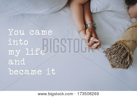 Inspirational quotes about love. Hand in hand of young couple background. You came into my life and became it.