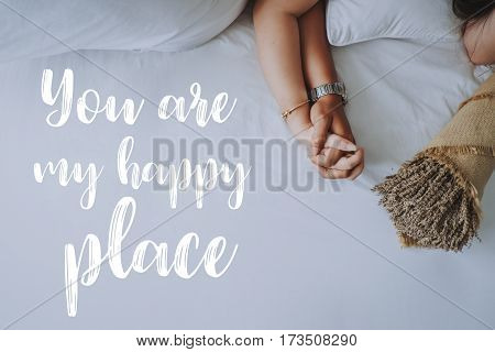 Inspirational quotes about love. Hand in hand of young couple background. You are my happy place.