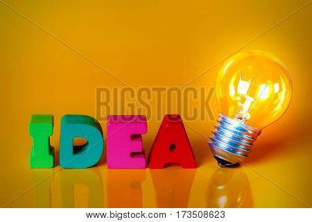 Clear Light Bulb With Colorful Wooden Alphabets