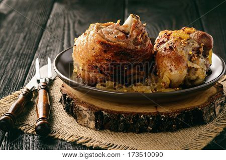 Baked turkey drumstick(knuckle) with onion and mustard sauce.