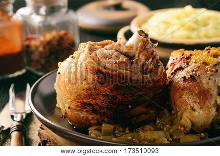 Baked turkey drumstick(knuckle) with onion and mustard sauce. Served with mashed potatoes.