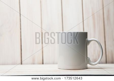 White tea cup on a white background retro boards
