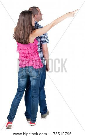 young couple pointing at wal Back view woman and man . Rear view people collection. backside view of person. Isolated over white background.