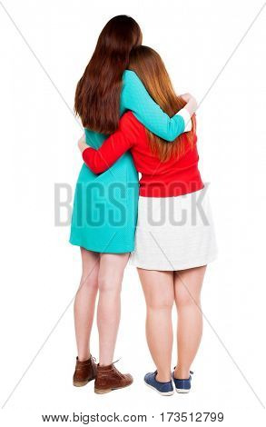 Back view of two young woman. Rear view people collection.  backside view of person. Rear view. Isolated over white background. She clung to his girlfriend