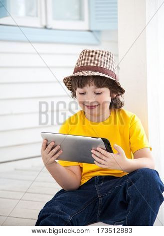 beauty boy with tablet pc indoors