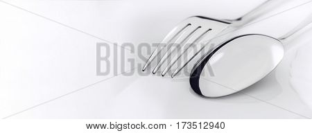 silverware fork, spoon on white table