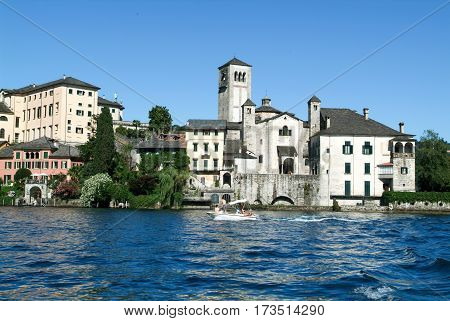 People On A Boat In Front Of San Giulio Island
