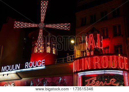 PARIS FRANCE - SEPTEMBER 19: Cabaret Moulin Rouge by night. French landmarks and travel destinations concept.