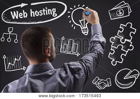 Technology, Internet, Business And Marketing. Young Business Man Writing Word: Web Hosting