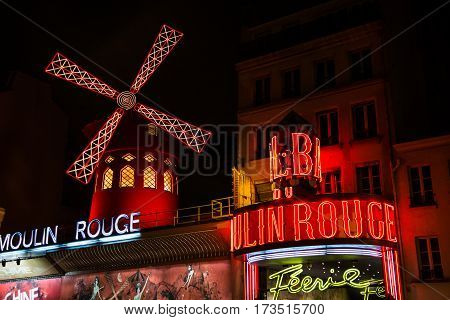 PARIS FRANCE - February 28, 2015: Cabaret Moulin Rouge by night. French landmarks and travel destinations concept.