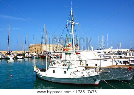 HERAKLION, CRETE - SEPTEMBER 19, 2016 - Yachts and boats moored in the harbour with Koules castle to the rear Heraklion Crete Greece Europe, September 19, 2016.