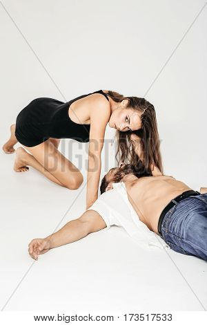 Pretty Girl Crawls To Bearded Man Lying On Floor