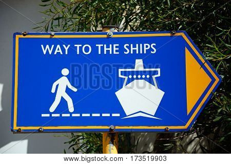 Blue way to the ships sign in the port Heraklion Crete Greece Europe.