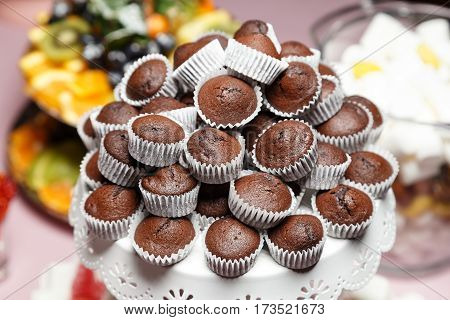 chocolate mini cupcakes on a plate lined with a slide a holiday Candy Bar