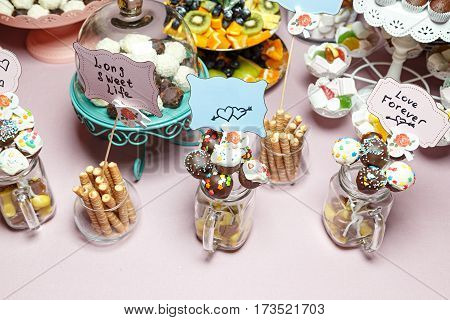 Candy bar with colorful sweets at a wedding