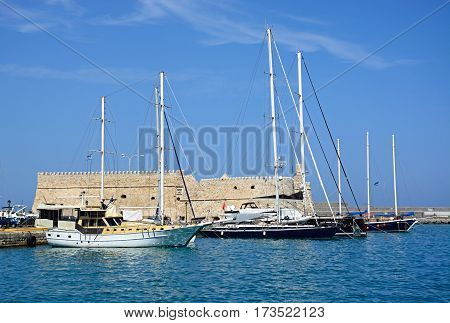 HERAKLION, CRETE - SEPTEMBER 19, 2016 - View of Koules castle with yachts in the harbour Heraklion Crete Greece Europe, September 19, 2016.