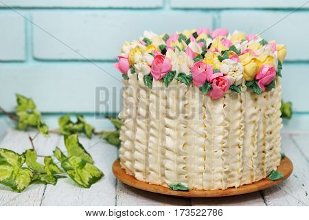 Gorgeous cake with spring decor. Basket of tulips for Valentine's Day and Mother's Day