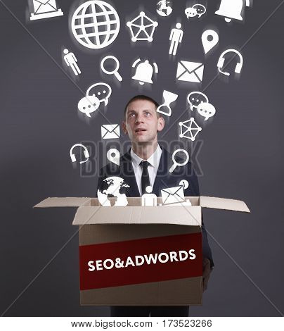 Business, Technology, Internet And Network Concept. Young Businessman Shows The Word: Seo&adwords