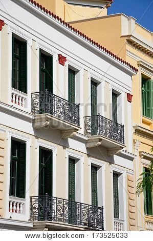 Greek building with wrought iron balconies in the city centre Heraklion Crete Greece Europe.