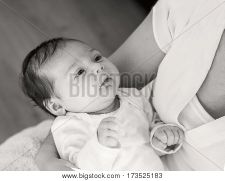 Black white photography mother and baby. Mother is holding her little baby girl.