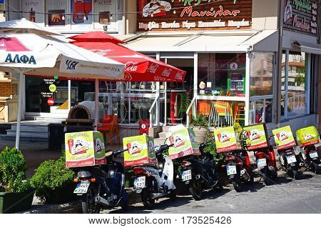 HERAKLION, CRETE - SEPTEMBER 19, 2016 - City centre restaurant with delivery bikes parked outside Heraklion Crete Greece Europe, September 19, 2016.