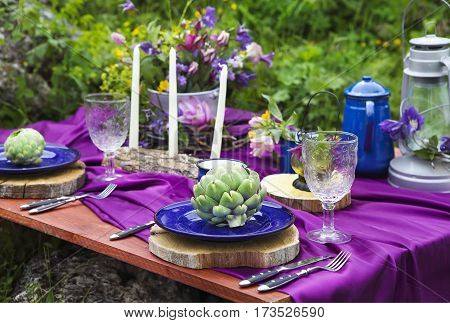 Wedding table setting decorated in rustic style. Mountains view