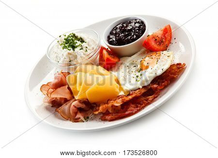 Breakfast - fried eggs, bacon, cheese and vegetables