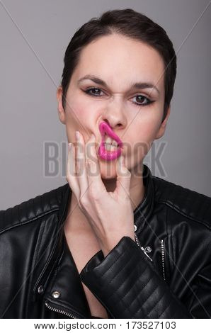Attractive Young Woman Wearing A Leather Jacket