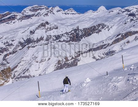 Mt. Titlis, Switzerland - 9 March, 2016: a person skiing. Titlis is a mountain, located on the border between Swiss cantons of Obwalden and Bern, mainly accessed from the town of Engelberg on the north side.